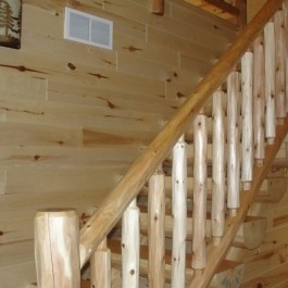 Cedar railing and pine log stairway
