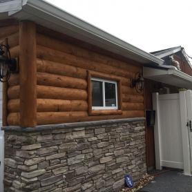 3x8 hewn cedar half log with 8x8x8 cedar vertical corners and 4x4 D trim