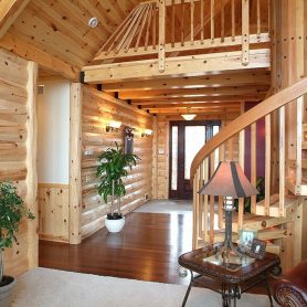 Half log siding and pre-finished knotty pine paneling
