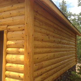 Garage with 4x8 4x10 and 4x12 Fatboy pine siding with 10x10 pine outside vertical log corners