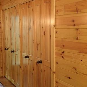 Bi-fold closet doors made with knotty pine paneling