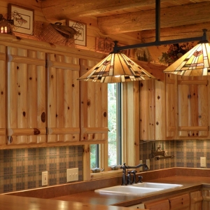 Knotty pine log upper cabinets, knotty pine log rafters, and knotty pine tongue and groove paneling