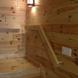 Knotty pine paneling staircase landing