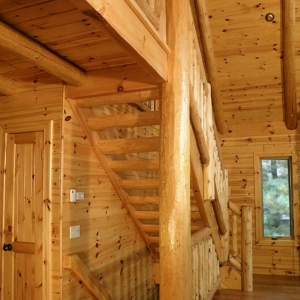 Tongue and groove paneling on the ceiling and knotty pine paneling and window trim