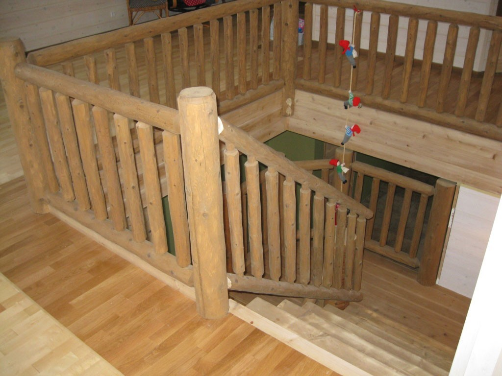 Half Log Staircase With A Cedar Railing