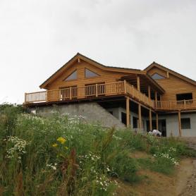 Cedar half log siding with cedar deck and railing