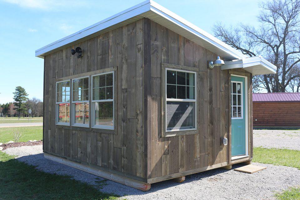 Barn wood siding on the exterior of a tiny beach house