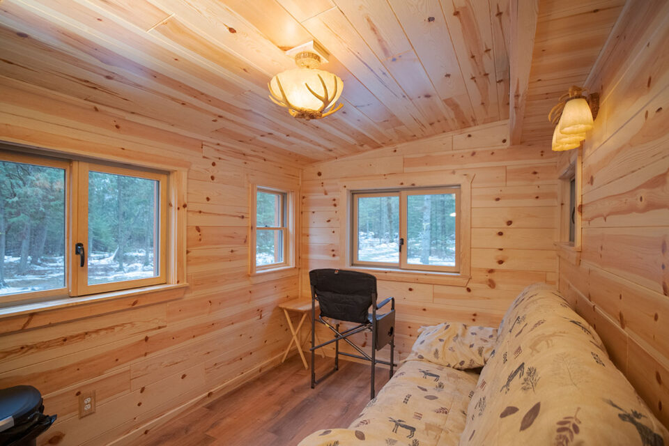 Knotty Pine walls and ceiling in two story deer blind