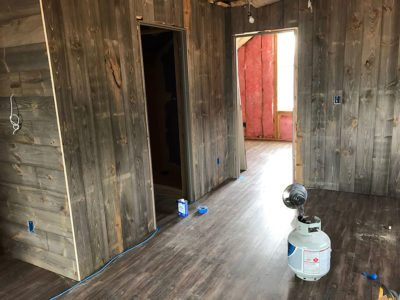 Barn wood paneling with sticker marks