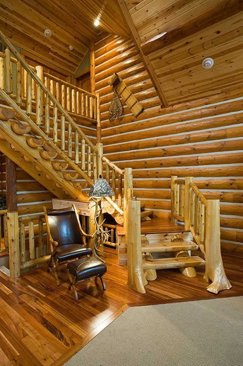 Flared Cedar Posts And Half Log Staircase