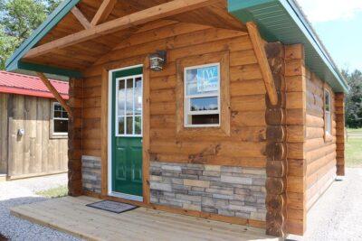 Tiny cabin with quarter-log siding